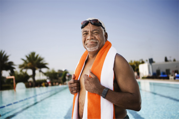 MyNotifi and NSCA work together to help seniors - swimmer wearing MyNotifi wristband device